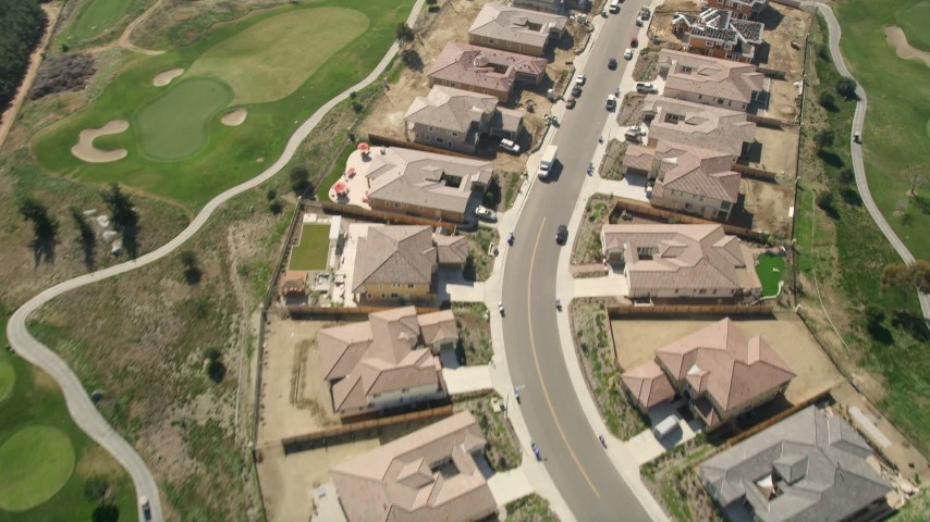 5K aerial video of residential neighborhood and new construction near golf course, Oceanside, California Aerial Stock Footage | AX0015_042