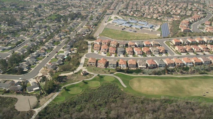 5K stock footage aerial video of a residential neighborhood and school in Oceanside, California Aerial Stock Footage | AX0015_043