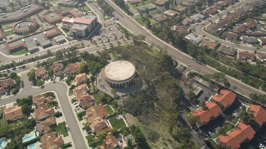 5K stock footage aerial video of a circular building in a residential community, Oceanside, California Aerial Stock Footage | AX0015_047