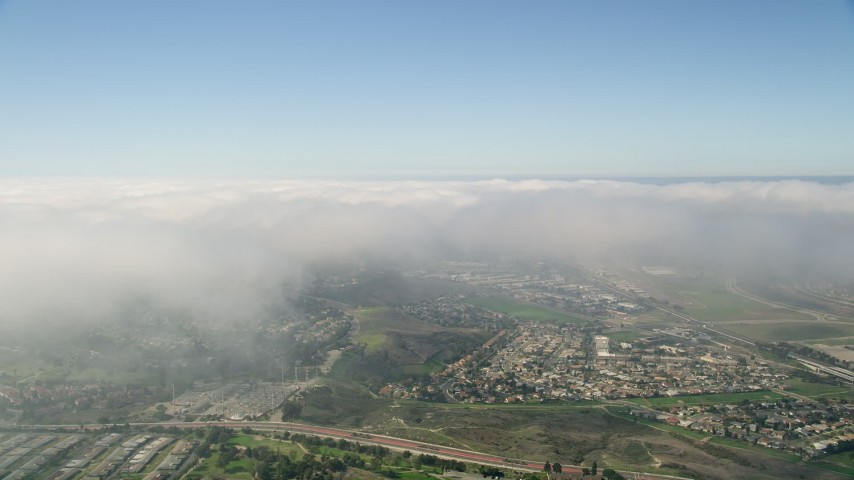 5K aerial video of clouds over a suburban community, Oceanside, California Aerial Stock Footage | AX0015_048
