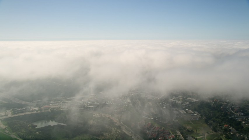 5K aerial stock footage video fly over a large break in the clouds covering Oceanside, California Aerial Stock Footage   AX0015_049