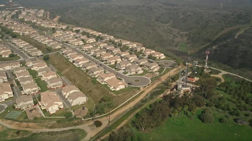 5K aerial video flyby tract homes in a residential neighborhood, Oceanside, California Aerial Stock Footage | AX0015_057