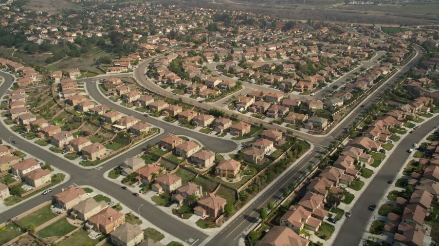5K stock footage aerial video fly over and past tract homes in a residential neighborhood, Oceanside, California Aerial Stock Footage AX0015_058 | Axiom Images