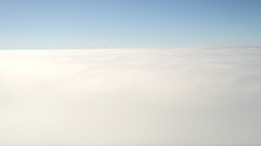 5K stock footage aerial video flyby and pan across thick cloud cover beneath blue skies, California Aerial Stock Footage | AX0016_001