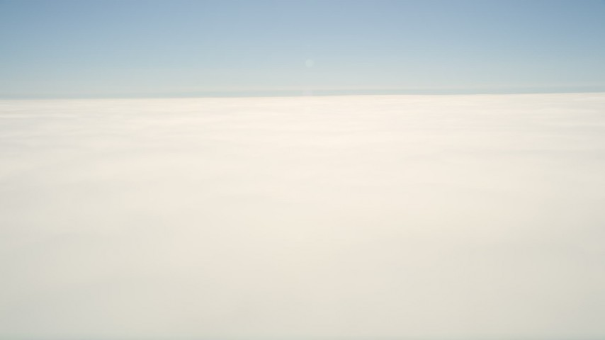 5K stock footage aerial video pan across thick cloud cover with blue sky above, California Aerial Stock Footage | AX0016_004