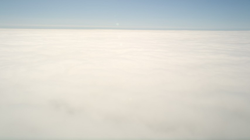5K aerial video of a reverse view of the edge of the clouds, then pan across the cloud layer, Oceanside, California Aerial Stock Footage | AX0016_008