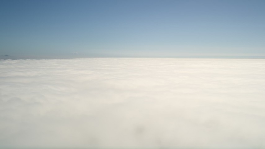 5K stock footage aerial video pan across the cloud layer beneath blue skies, California Aerial Stock Footage | AX0016_009