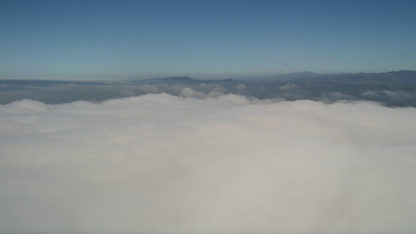 5K stock footage aerial video of panning across the top of the cloud layer to reveal the edge, California Aerial Stock Footage | AX0016_012