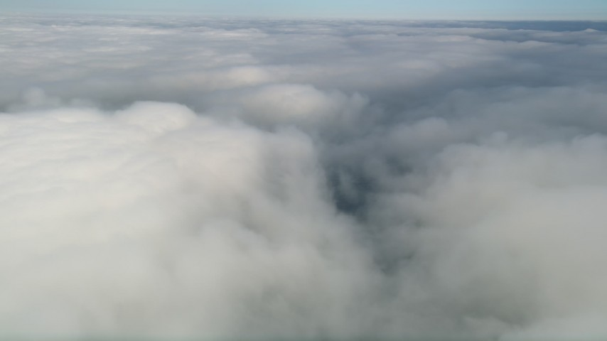 5K stock footage aerial video pan across dense clouds over California Aerial Stock Footage | AX0016_018