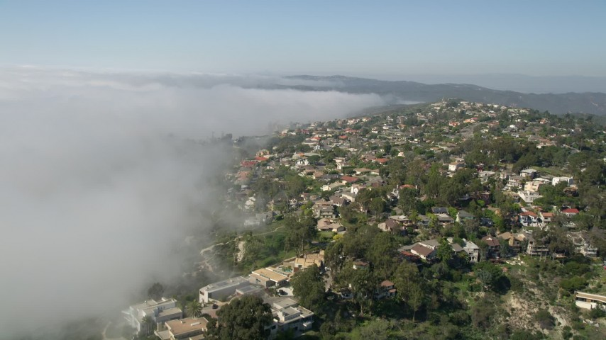 5K aerial video fly over upscale hillside homes and rolling fog, Laguna Niguel, California Aerial Stock Footage | AX0016_058