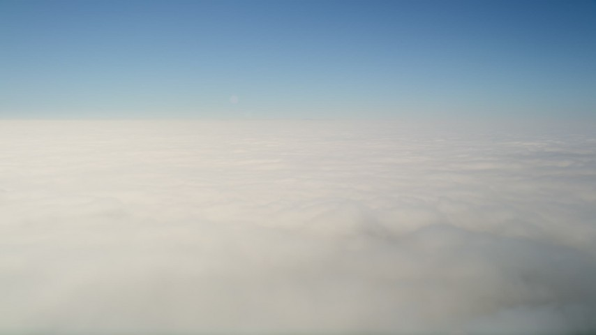5K stock footage aerial video of dense cloud cover and blue skies, California Aerial Stock Footage | AX0016_060
