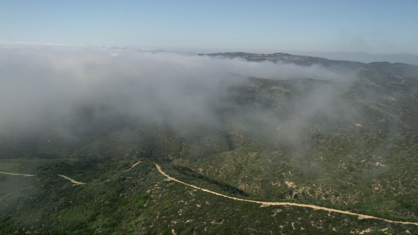 5K aerial video fly over green hills and rolling fog, Laguna Beach, California Aerial Stock Footage | AX0016_064