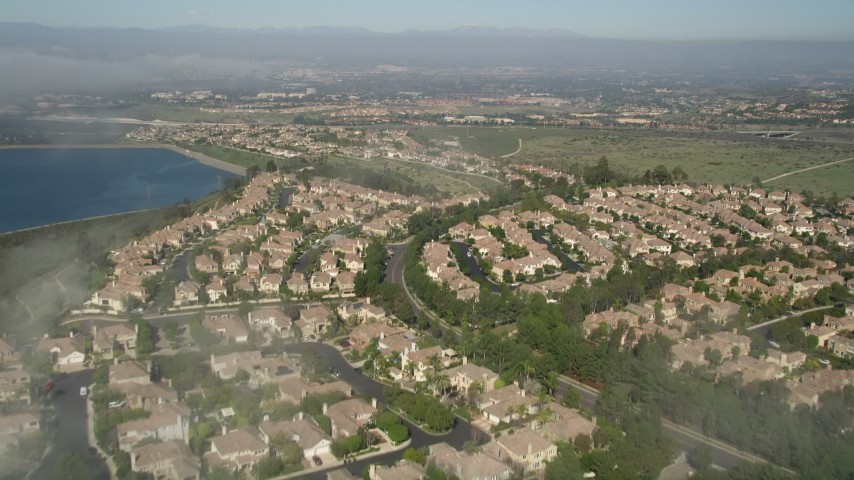5K stock footage aerial video fly over residential neighborhood beside the San Joaquin Reservoir, Newport Beach, California Aerial Stock Footage | AX0016_073