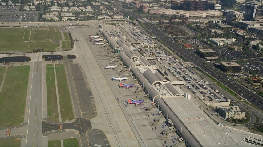 5K stock footage aerial video of passenger jets at terminals, John Wayne Airport, Orange County, California Aerial Stock Footage | AX0016_083
