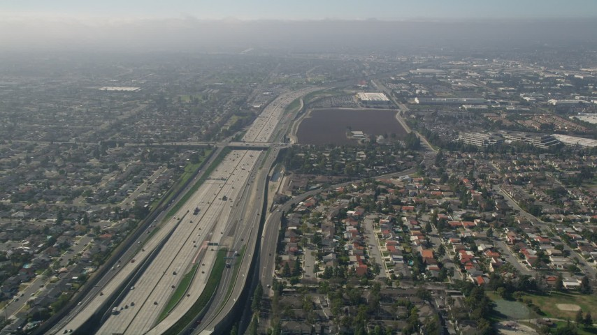 5K aerial video tilt from a bird's eye view of Interstate 405 and reveal the Highway 73 interchange, Costa Mesa, California Aerial Stock Footage | AX0016_088
