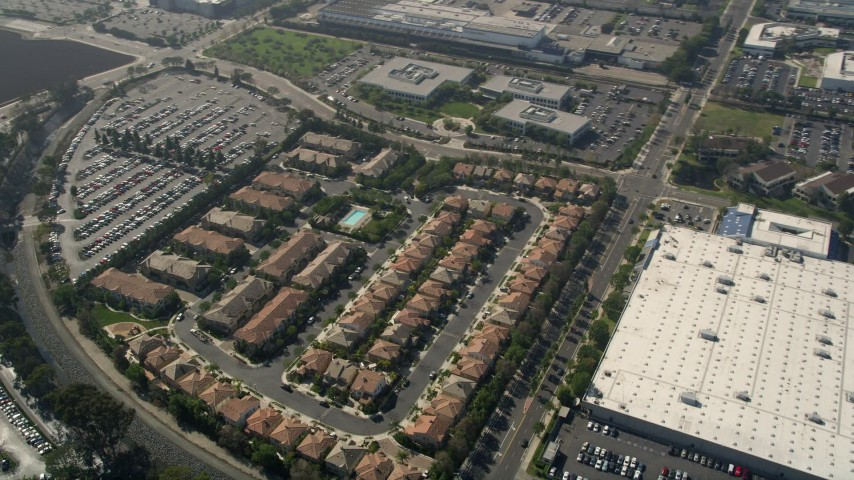 5K stock footage aerial video of apartment buildings and tract homes beside a US Post Office facility, Costa Mesa, California Aerial Stock Footage | AX0016_090