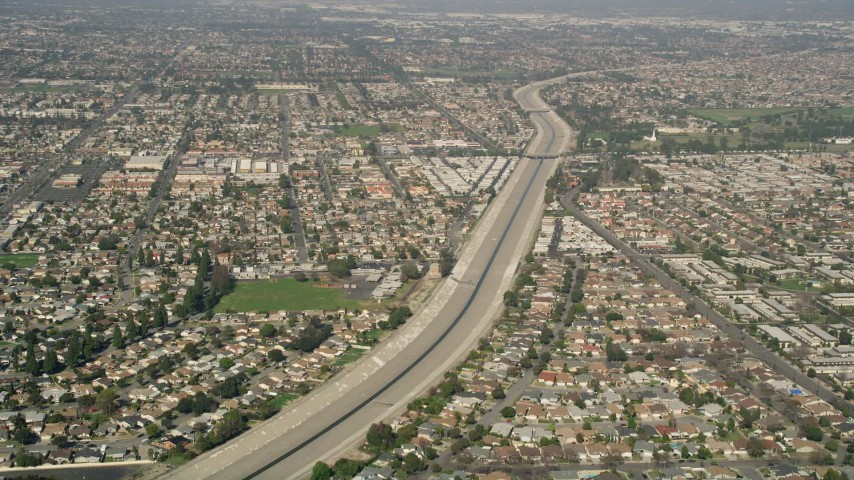 5K stock footage aerial video of Coyote Creek and suburban neighborhoods in Los Alamitos, California Aerial Stock Footage | AX0016_102