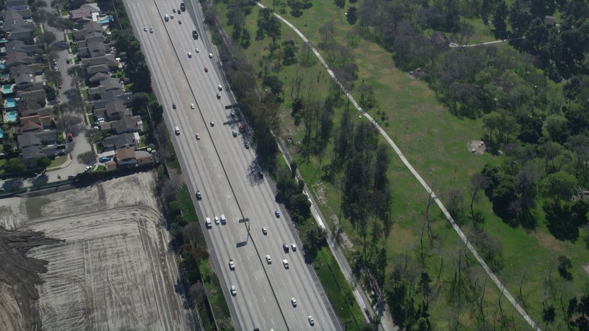 5K stock footage aerial video track light traffic on Interstate 605, Long Beach, California Aerial Stock Footage | AX0016_104