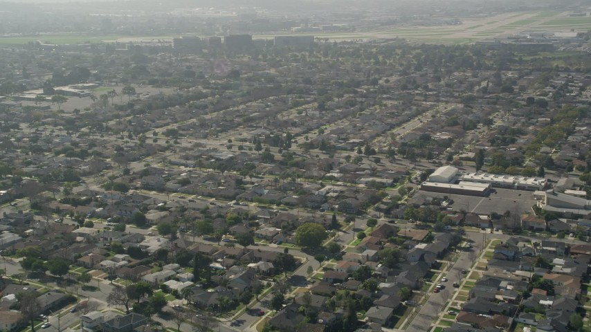 5K aerial video fly by residential neighborhoods in Long Beach, California Aerial Stock Footage | AX0016_107