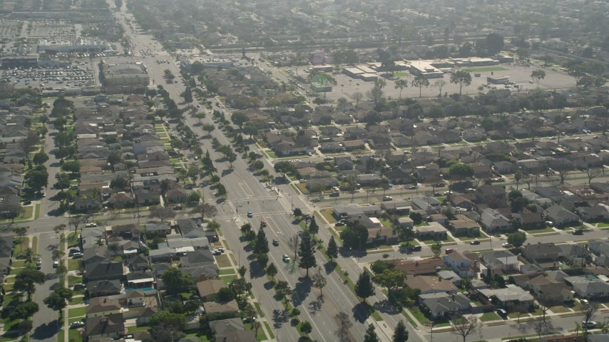 5K stock footage aerial video of Bellflower Boulevard through residential neighborhoods, Long Beach, California Aerial Stock Footage | AX0016_108