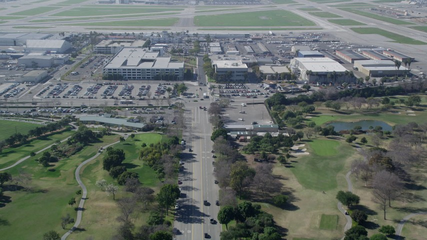 5K aerial video tilt from East Warlow Road to reveal and approach parking garage at Long Beach Airport, California Aerial Stock Footage | AX0016_109