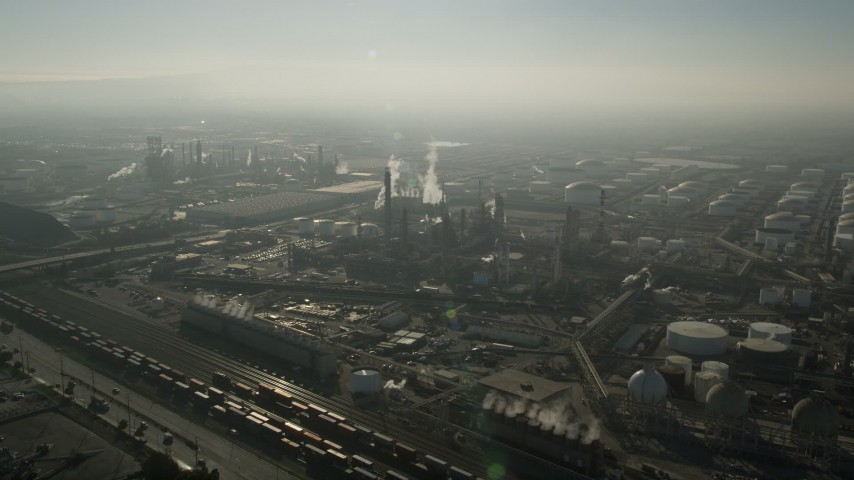 5K stock footage aerial video of approaching an oil refinery with smoke stacks, Carson, California Aerial Stock Footage | AX0017_002E