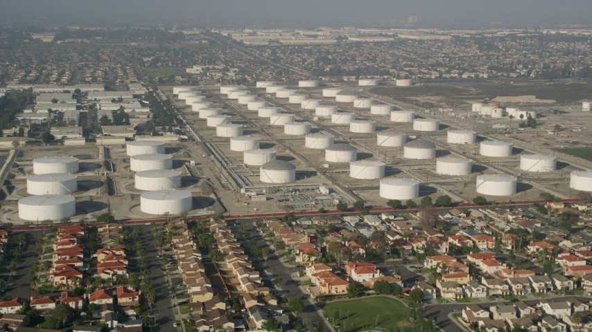 5K stock footage aerial video approach residential neighborhood and storage tanks, Carson, California Aerial Stock Footage | AX0017_008E