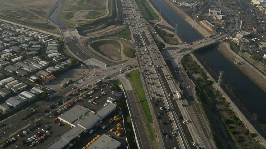 5K stock footage aerial video of following heavy traffic on Interstate 405 and tilt up, Carson, California Aerial Stock Footage | AX0017_023
