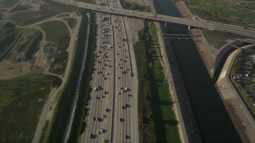 5K stock footage aerial video of following heavy interstate traffic along the river, Carson, California Aerial Stock Footage | AX0017_024