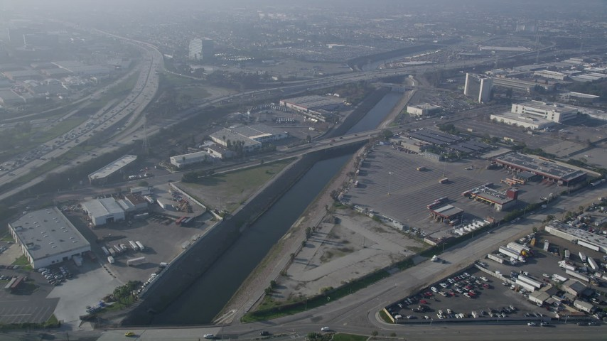 5K stock footage aerial video of following the Los Angeles River near Interstate 110; Carson, California Aerial Stock Footage | AX0017_025