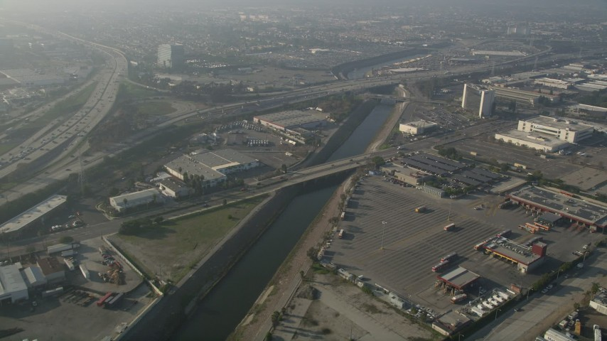 5K stock footage aerial video of following the Los Angeles River near Interstate 110; Carson, California Aerial Stock Footage | AX0017_025E