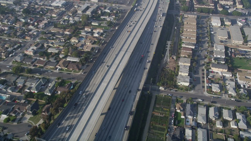 5K stock footage aerial video of following Interstate 110 along residential area, Gardena, California Aerial Stock Footage | AX0017_028