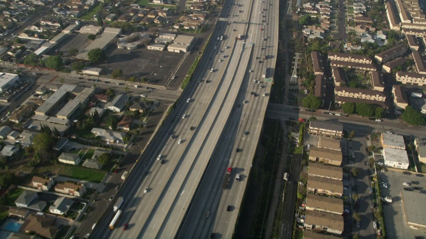 5K stock footage aerial video of following Interstate 110 along residential area, Gardena, California Aerial Stock Footage | AX0017_028E