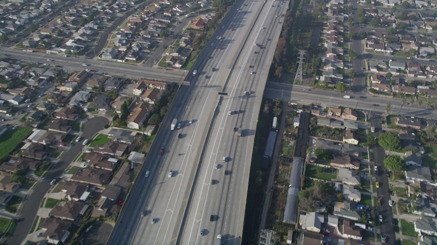 5K stock footage aerial video of following Interstate 110 along residential area, Gardena, California Aerial Stock Footage | AX0017_029