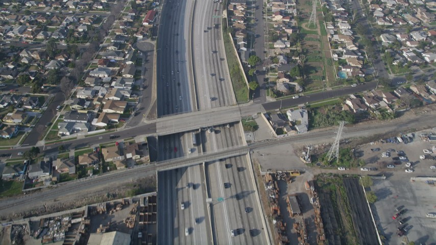 5K stock footage aerial video of following Interstate 110 along residential area, Gardena, California Aerial Stock Footage | AX0017_030