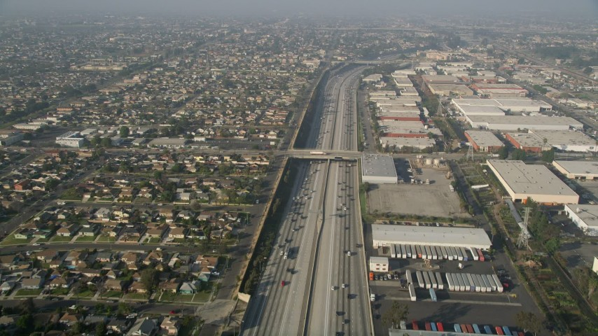 5K stock footage aerial video of Interstate 110 along residential and industrial area, Gardena, California Aerial Stock Footage | AX0017_032
