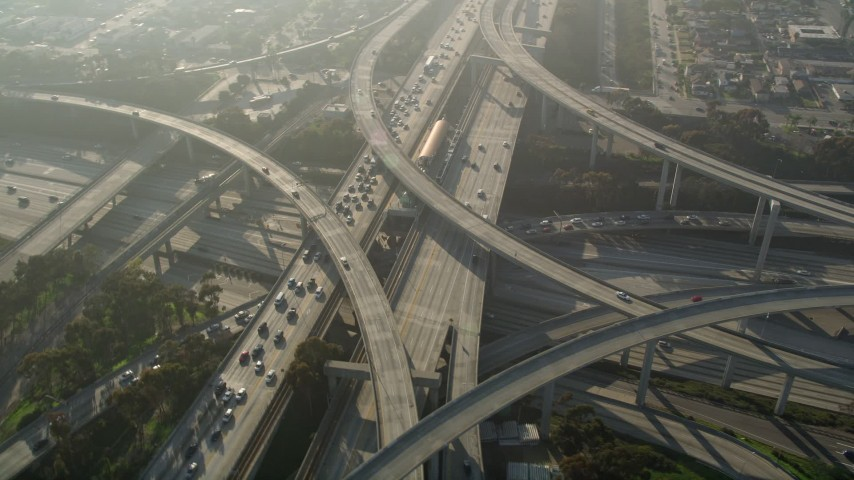 5K stock footage aerial video of following Interstate 110 and approaching interchange with Interstate 105, Westmont, California Aerial Stock Footage | AX0017_033