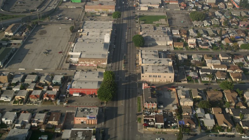 5K aerial video of following a city street past apartment buildings, South Central Los Angeles Aerial Stock Footage | AX0017_036