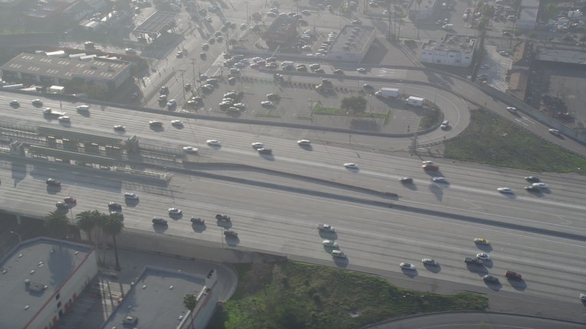 5K aerial video of tracking cars on Interstate 110, South Central Los Angeles Aerial Stock Footage | AX0017_037
