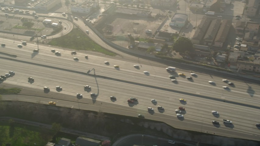 5K stock footage aerial video of cars on Interstate 110, South Central Los Angeles Aerial Stock Footage | AX0017_037E