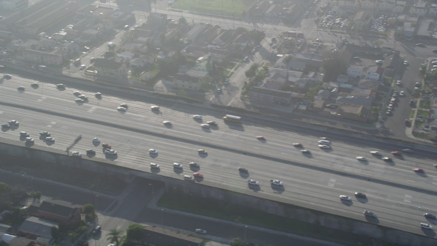 5K aerial video of tracking traffic on Interstate 110, South Central Los Angeles Aerial Stock Footage | AX0017_038