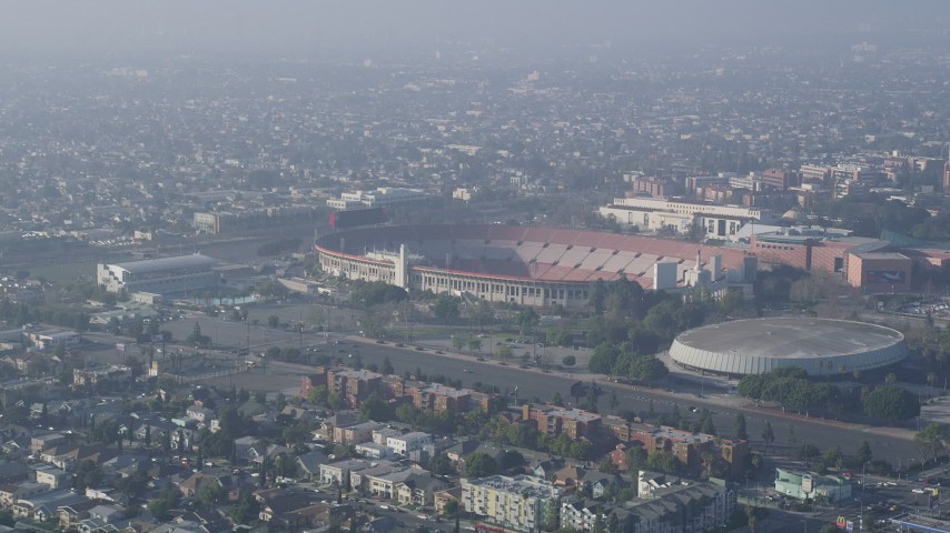 5K stock footage aerial video approach Los Angeles Memorial Coliseum, California Aerial Stock Footage | AX0017_040