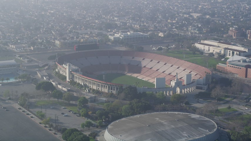 5K stock footage aerial video of Los Angeles Memorial Coliseum, California Aerial Stock Footage AX0017_041 | Axiom Images