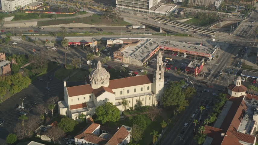 5K aerial video tilt down to a bird's eye of St. Vincent Catholic Church, Los Angeles, California Aerial Stock Footage | AX0017_058