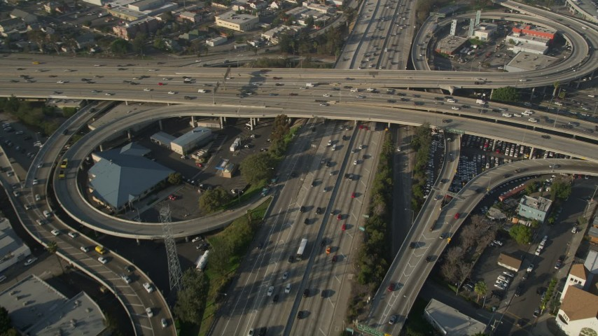 5K stock footage aerial video of following Interstate 110 over the 10 interchange, Downtown Los Angeles Aerial Stock Footage AX0017_060