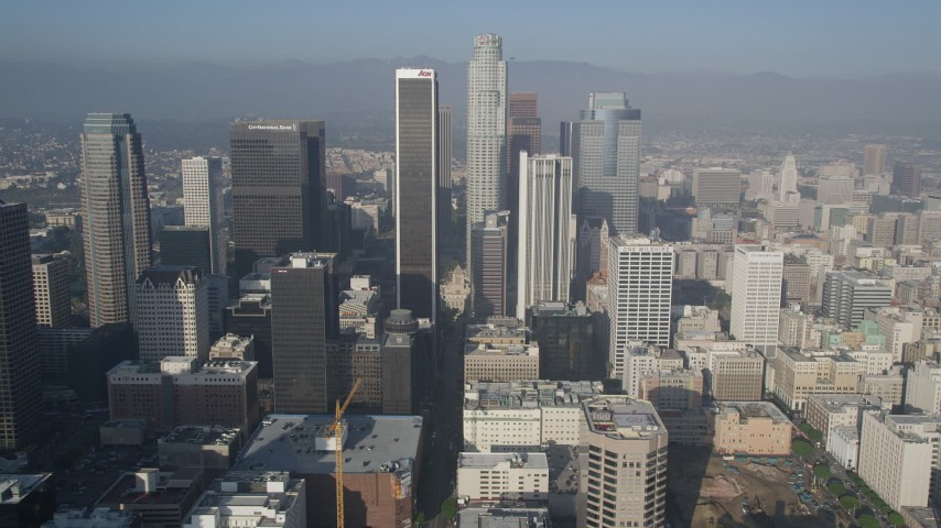 5K aerial video fly by skyscrapers toward US Bank Tower, Downtown Los Angeles, California Aerial Stock Footage | AX0017_063