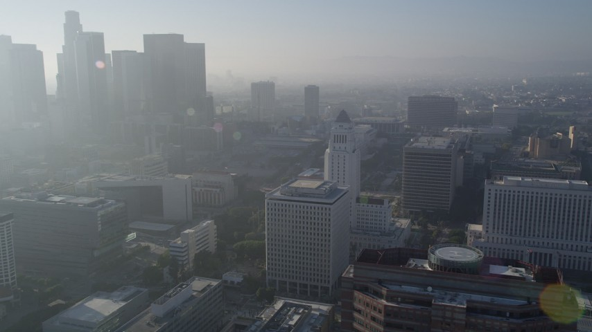 5K stock footage aerial video of orbiting City Hall revealing skyscrapers, Downtown Los Angeles Aerial Stock Footage | AX0017_066