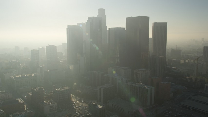 5K stock footage aerial video tilt up revealing City Hall and skyscrapers, Downtown Los Angeles Aerial Stock Footage | AX0017_067