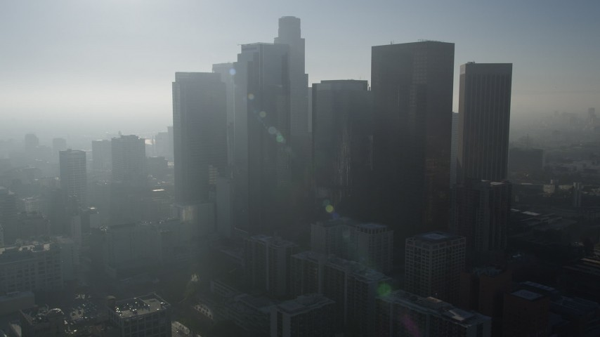 5K stock footage aerial video of flying over skyscrapers toward US Bank Tower, Downtown Los Angeles Aerial Stock Footage | AX0017_068
