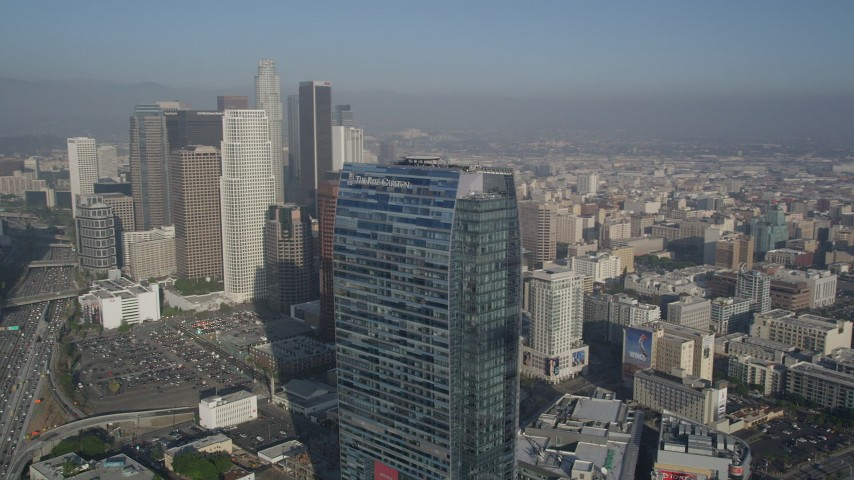 5K aerial video of orbiting Ritz Carlton revealing skyscrapers, Downtown Los Angeles Aerial Stock Footage | AX0017_071